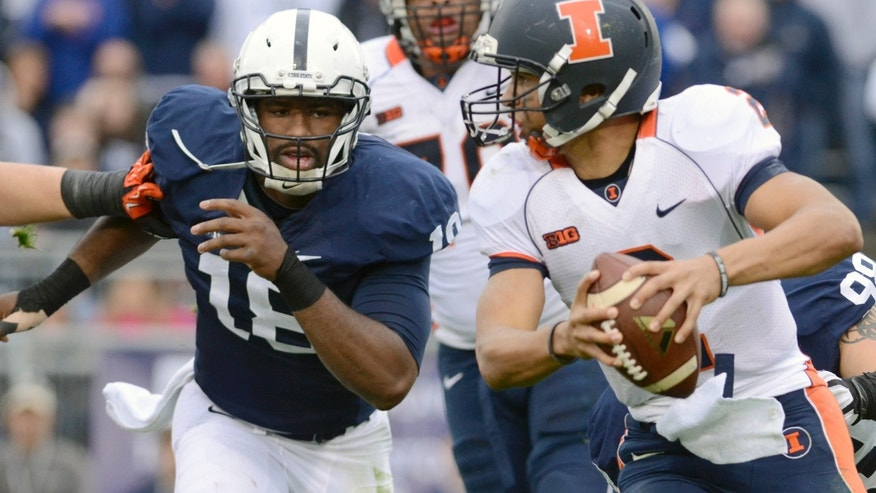 Penn State defensive end Deion Barnes (18) puts pressure on Illinois quarterback Nathan Scheelhaase (2) in the second half of an NCAA college football game against Penn State in State College, Pa., Saturday, Nov. 2, 2013. (AP Photo/John Beale)