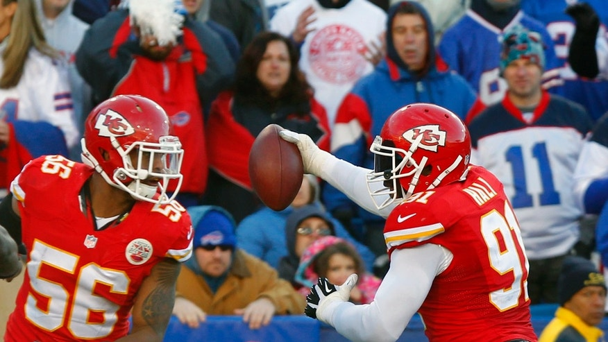 Kansas City Chiefs outside linebacker Tamba Hali (91) runs into the endzone for a touchdown after recovering a fumble as Kansas City Chiefs inside linebacker Derrick Johnson (56) blocks during the third quarter of an NFL football game against the Buffalo Bills in Orchard Park, N.Y., Sunday, Nov. 3, 2013. (AP Photo/ Bill Wippert)