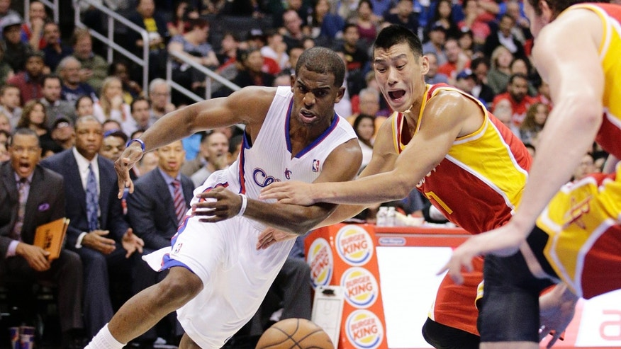 Los Angeles Clippers' Chris Paul, left, and Houston Rockets' Jeremy Lin look at a loose ball during the first half of an NBA basketball game on Monday, Nov. 4, 2013, in Los Angeles. (AP Photo/Jae C. Hong)