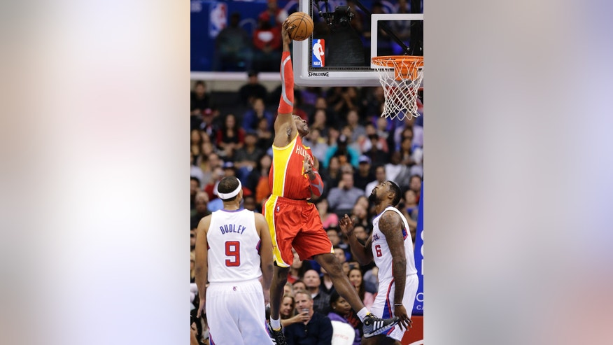 Houston Rockets' Dwight Howard, center, puts up a shot as Los Angeles Clippers' Jared Dudley, bottom left, and DeAndre Jordan watch during the first half of an NBA basketball game on Monday, Nov. 4, 2013, in Los Angeles. (AP Photo/Jae C. Hong)