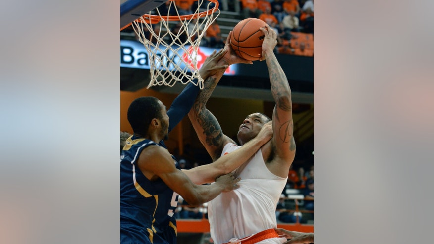 Syracuse's DaJuan Coleman, right, is fouled by Ryerson's Aaron Best during the second half of a men's NCAA exhibition basketball game in Syracuse, N.Y., Tuesday, Nov. 5, 2013. Syracuse won 81-46. (AP Photo/Kevin Rivoli)