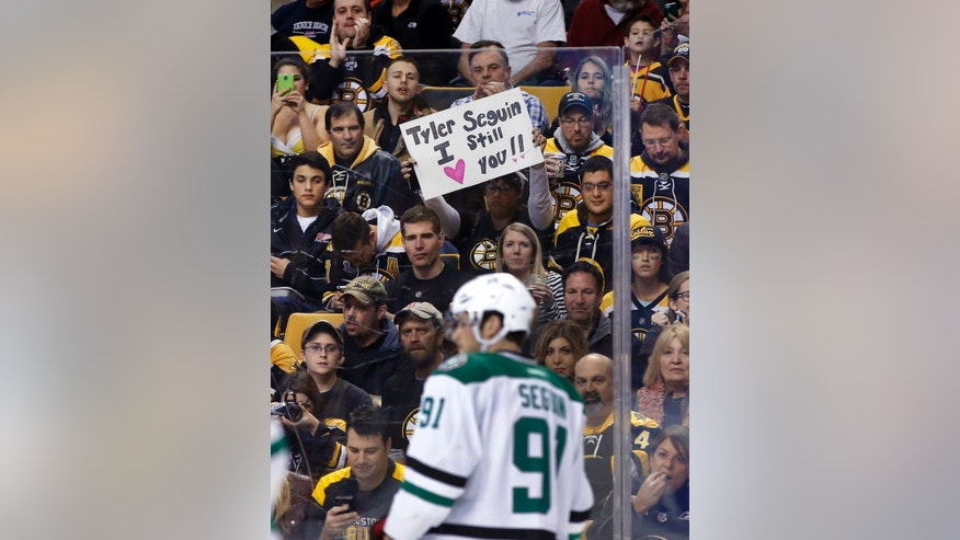 A fan holds up a sign for former Boston Bruin and current Dallas Stars center Tyler Seguin (91) during the first period of an NHL hockey game in Boston on Tuesday, Nov. 5, 2013. (AP Photo/Elise Amendola)