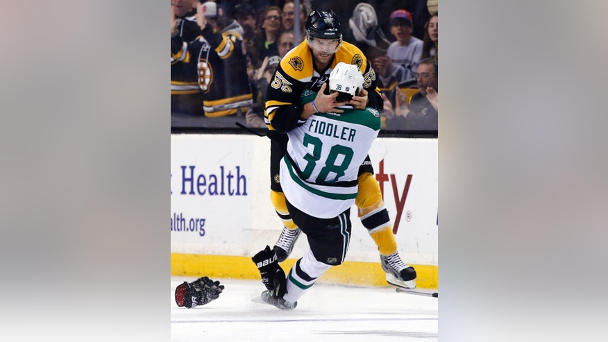 Boston Bruins defenseman Johnny Boychuk (55) fights with Dallas Stars center Vernon Fiddler (38) during the first period of an NHL hockey game in Boston on Tuesday, Nov. 5, 2013. (AP Photo/Elise Amendola)