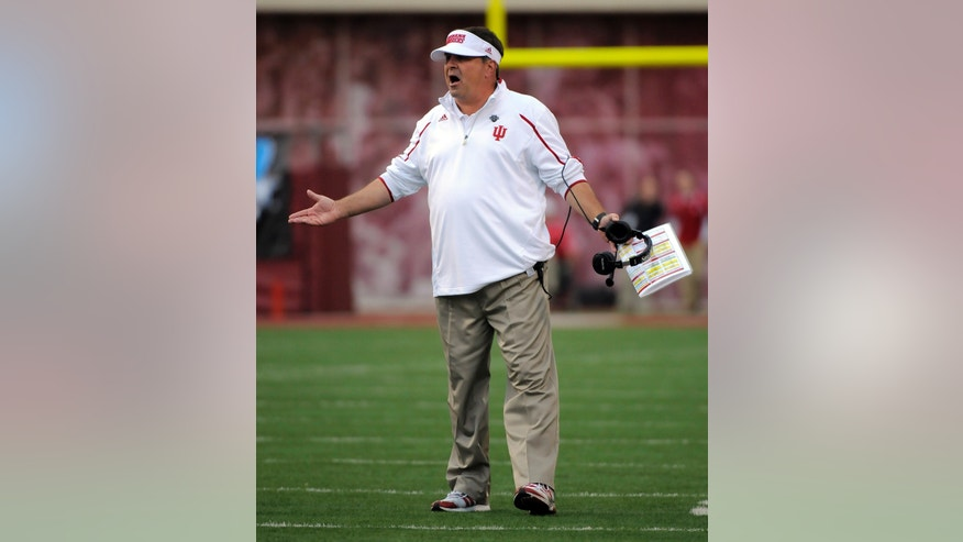 Indiana's head coach Kevin Wilson reacts to a field goal during the first half of an NCAA college football game against Minnesota in Bloomington, Ind., Saturday, Nov. 2, 2013. (AP Photo/ Alan Petersime)