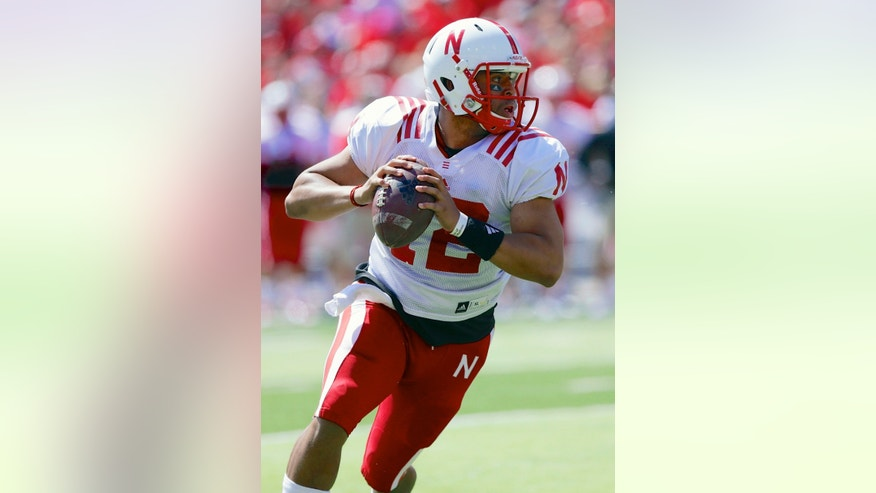 FILE -  In this April 6, 2013 file photo, quarterback Ron Kellogg III carries the ball during the annual Nebraska NCAA college football spring game in Lincoln, Neb. Kellogg has been the consummate good soldier for five years at Nebraska. The former walk-on never has been a serious candidate for the starting quarterback's job, but he's been a sideline resource for whoever it's been. Finally, his big moment came. His Hail Mary heave from midfield that landed in Jordan Westerkamp's hands to beat Northwestern will long live in Cornhuskers lore. (AP Photo/Nati Harnik, FILE)