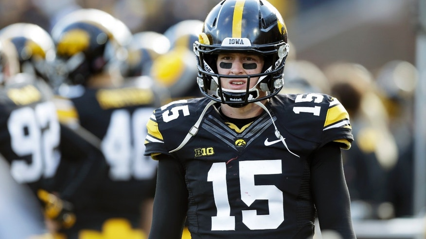 Iowa quarterback Jake Rudock walks on the sidelines after getting injured during the second half of an NCAA college football game against Wisconsin, Saturday, Nov. 2, 2013, in Iowa City, Iowa. Wisconsin won 28-9. (AP Photo/Charlie Neibergall)