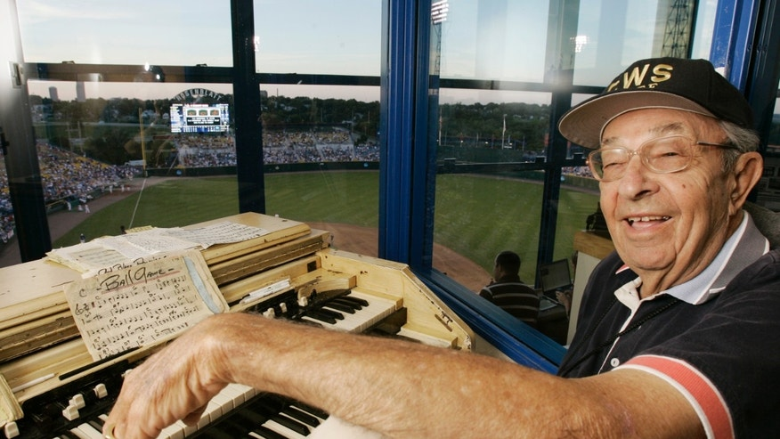 FILE - In this June 22, 2008 file photo, organist Lambert Bartak poses in his booth during the College World Series at Rosenblatt Stadium, in Omaha, Neb. Bartak, the organist who entertained Rosenblatt Stadium's baseball fans for more than half a century, died Sunday, Nov. 3, 2013 in San Diego. He was 94. (AP Photo/Nati Harnik, File)