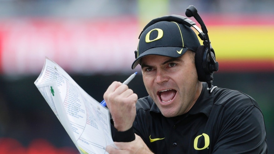 FILE - In this Oct. 12, 2013 file photo, Oregon coach Mark Helfrich looks for a holding call in the first half of an NCAA college football game against Washington, in Seattle. Helfrich and Stanford's David Shaw shared some laughs in the offseason about questions concerning their promotions to head coach. Nobody is doubting them this week. No. 2 Oregon is undefeated heading into Thursday night's, Nov. 7, 2013, matchup at No. 6 Stanford. (AP Photo/Elaine Thompson, File)