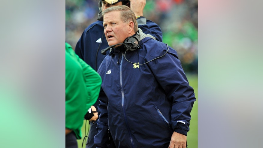 Notre Dame coach Brian Kelly talks to the officials in the first half of an NCAA college football game against Navy, Saturday, Nov. 2, 2013, in South Bend, Ind. (AP Photo/Joe Raymond)