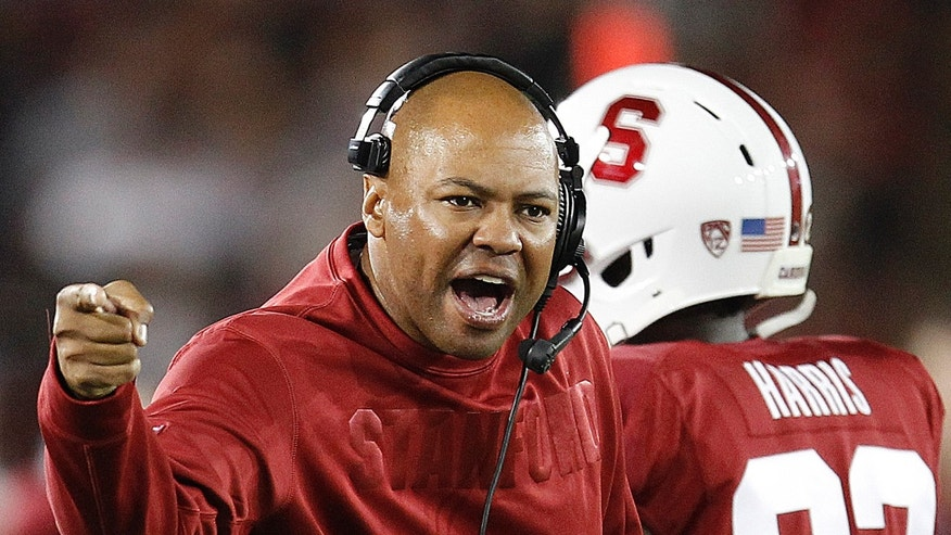 FILe - In this Sept. 7, 2013 file photo, Stanford head coach David Shaw argues a call with an official during the second half of an NCAA college football game against San Jose State in Stanford, Calif. Oregon's Mark Helfrich and Stanford's David Shaw shared some laughs in the offseason about questions concerning their promotions to head coach. Nobody is doubting them this week. No. 2 Oregon is undefeated heading into Thursday night's, Nov. 7, 2013, matchup at No. 6 Stanford.  (AP Photo/Tony Avelar, File)