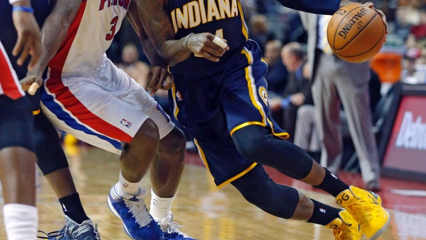 Detroit Pistons guard Rodney Stuckey (3) tries to stay with Indiana Pacers forward Paul George, right, during the first half of an NBA basketball game Tuesday, Nov. 5, 2013, in Auburn Hills, Mich. (AP Photo/Duane Burleson)