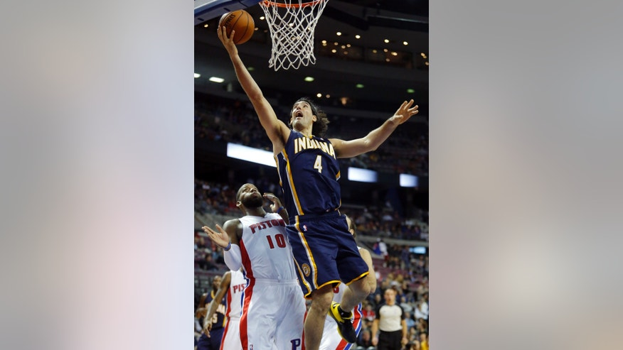 Indiana Pacers forward Luis Scola (4) goes to the basket past Detroit Pistons center Greg Monroe (10) during the first half of an NBA basketball game Tuesday, Nov. 5, 2013, in Auburn Hills, Mich. (AP Photo/Duane Burleson)
