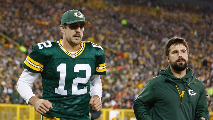 Green Bay Packers' Aaron Rodgers heads to the locker room after being hurt during the first half of an NFL football game against the Chicago Bears Monday, Nov. 4, 2013, in Green Bay, Wis. (AP Photo/Jeffrey Phelps)