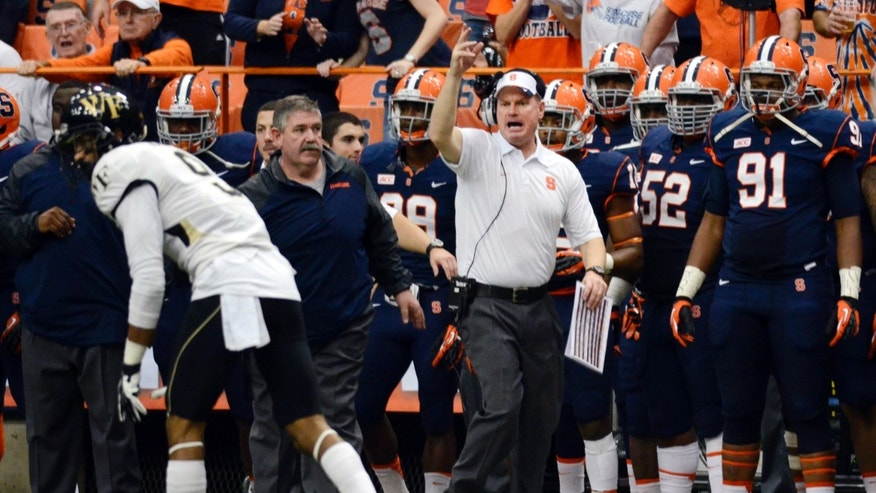 Syracusecoach, Scott Shafer, center, shouts along the sidelines during an NCAA college football game against Wake Forest at the Carrier Dome in Syracuse, N.Y., Saturday, Nov. 2, 2013. Syracuse defeated Wake Forest 13-0. (AP Photo/Heather Ainsworth)