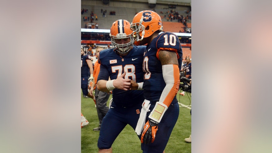Syracuse's Jason Emerich, left, and Terrel Hunt congratulate one another after defeating Wake Forest 13-0 in an NCAA college football game at the Carrier Dome in Syracuse, N.Y., Saturday, Nov. 2, 2013. (AP Photo/Heather Ainsworth)