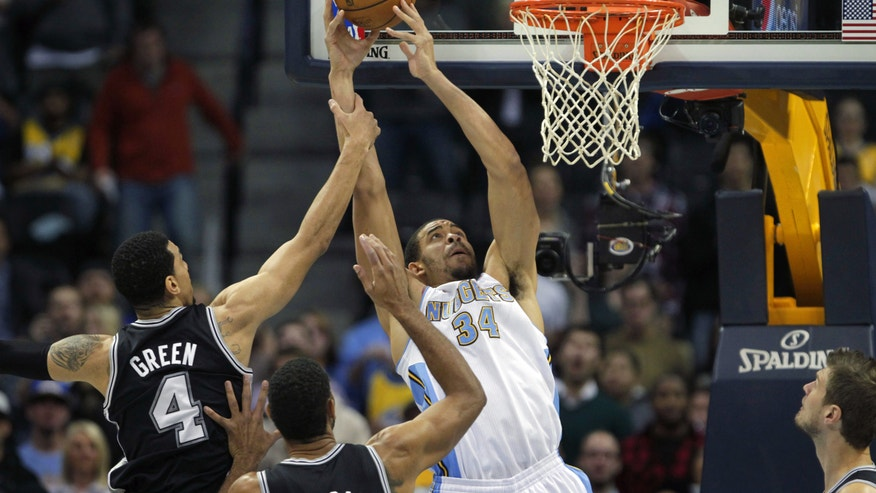 San Antonio Spurs guard Danny Green (4) fouls Denver Nuggets center JaVale McGee (34) in the first quarter of a basketball game in Denver on Tuesday, Nov. 5, 2013. (AP Photo/Joe Mahoney)