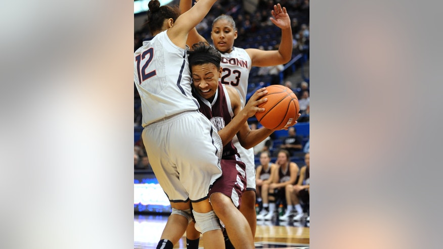 Connecticut's Saniya Chong, left, and Kaleena Mosqueda-Lewis, right, pressure Philadelphia's Bria Young during the second half of an NCAA college exhibition basketball game, Tuesday, Nov. 5, 2013, in Hartford, Conn. Connecticut won 93-28. (AP Photo/Jessica Hill)
