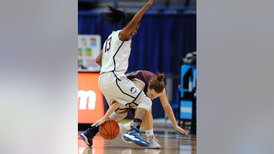 Connecticut's Brianna Banks, left, pressures Philadelphia's Monica Schacker during the first half of an NCAA college exhibition basketball game, Tuesday, Nov. 5, 2013, in Hartford, Conn. (AP Photo/Jessica Hill)