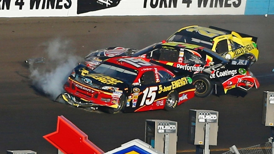 FILE - In this Nov. 11, 2012 file photo, from left, Clint Bowyer (15), Jeff Gordon and Joey Logano crash in Turn 4 during the NASCAR Sprint Cup Series auto race at Phoenix International Raceway in Avondale, Ariz. When Gordon intentionally spun Bowyer at Phoenix last year, it triggered a melee in the garage between two teams and led to severe sanctions against the four-time NASCAR champion. A year after the incident, the relationship between Gordon and Bowyer has not been repaired. (AP Photo/The Arizona Republic, Rob Schumacher, File)  MARICOPA COUNTY OUT; MAGS OUT; NO SALES