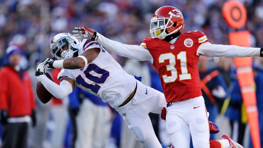 Buffalo Bills wide receiver Robert Woods (10) attempts to make a catch with Kansas City Chiefs cornerback Marcus Cooper (31) defending during the third quarter of an NFL football game in Orchard Park, N.Y., Sunday, Nov. 3, 2013. Woods was injured on the play and left the game. (AP Photo/Gary Wiepert)