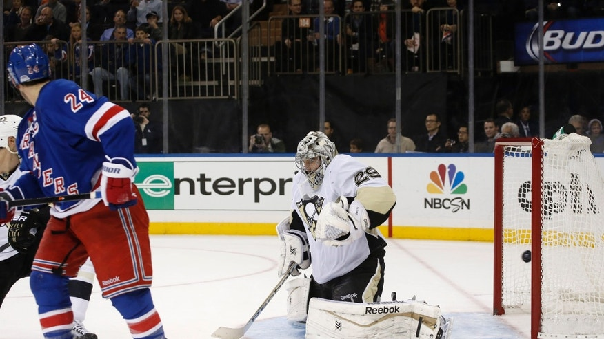 New York Rangers right wing Ryan Callahan (24) watches his goal against Pittsburgh Penguins goalie Marc-Andre Fleury in the second period of their NHL hockey game at Madison Square Garden in New York, Wednesday, Nov. 6, 2013. (AP Photo/Kathy Willens)