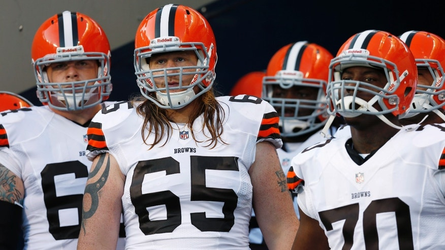 Aug. 29, 2013: In this photo, Cleveland Browns offensive tackles Garrett Gilkey (65) and Chris Faulk (70) wait before running onto the field before a preseason NFL football game against the Chicago Bears in Chicago.