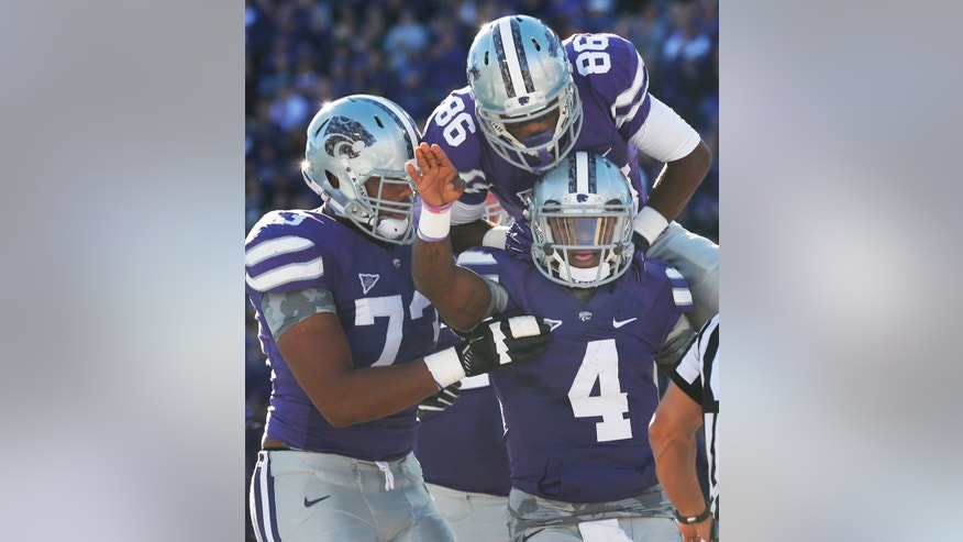 Kansas State quarterback Daniel Sams (4) celebrates his touchdown with teammates Tramaine Thompson (86) and Tavon Rooks (73) during the first half of an NCAA college football game against Iowa State at Bill Snyder Family Stadium in Manhattan, Kan., Saturday, Nov. 2, 2013. (AP Photo/Orlin Wagner)