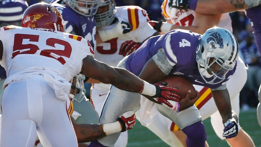 Kansas State quarterback Daniel Sams (4) slips past Iowa State linebacker Jeremiah George (52) for a touchdown during the first half of an NCAA college football game at Bill Snyder Family Stadium in Manhattan, Kan., Saturday, Nov. 2, 2013. (AP Photo/Orlin Wagner)