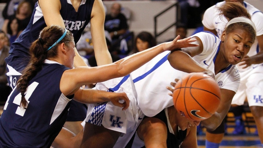 Kentucky's DeNesha Stallworth, top right, recovers a loose ball over Eckerd's Victoria Vine and Amy Buccilla, left, during the second half of an NCAA college basketball exhibition, Sunday, Nov. 3, 2013, in Lexington, Ky. Kentucky won 83-35. (AP Photo/James Crisp)