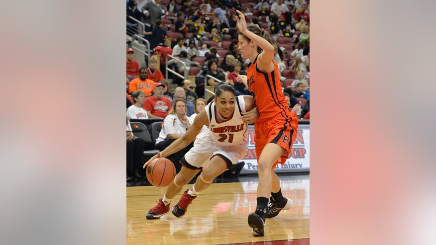 Louisville's Bria Smith, left, drives under the defense of Pikeville's Kandice Porter during the second half of an NCAA college basketball exhibition game, Tuesday, Nov. 5, 2013, in Louisville, Ky. Louisville defeated Pikeville 127-40. (AP Photo/Timothy D. Easley)