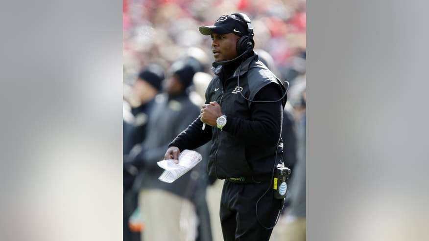 Purdue head coach Darrell Hazell watches his team as they played Ohio State during the second half of an NCAA college football game in West Lafayette, Ind., Saturday, Nov. 2, 2013. Ohio State defeated Purdue 56-0. (AP Photo/Michael Conroy)