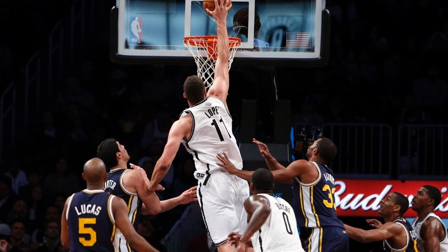 Brooklyn Nets' Brook Lopez (11) dunks against against the Utah Jazz during the first half of an NBA basketball game Tuesday, Nov. 5, 2013, in New York. (AP Photo/Jason DeCrow)