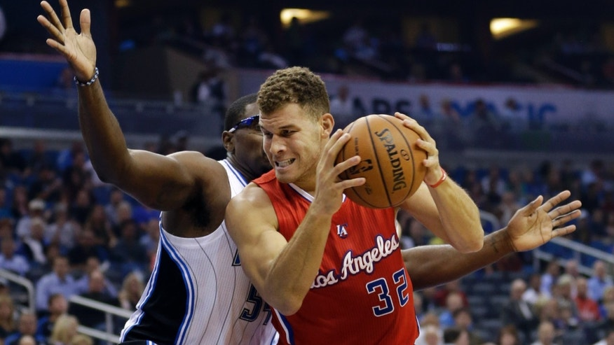 Los Angeles Clippers' Blake Griffin (32) makes a move to the basket as he is defended by Orlando Magic's Jason Maxiell during the first half of an NBA basketball game in Orlando, Fla., Wednesday, Nov. 6, 2013. (AP Photo/John Raoux)