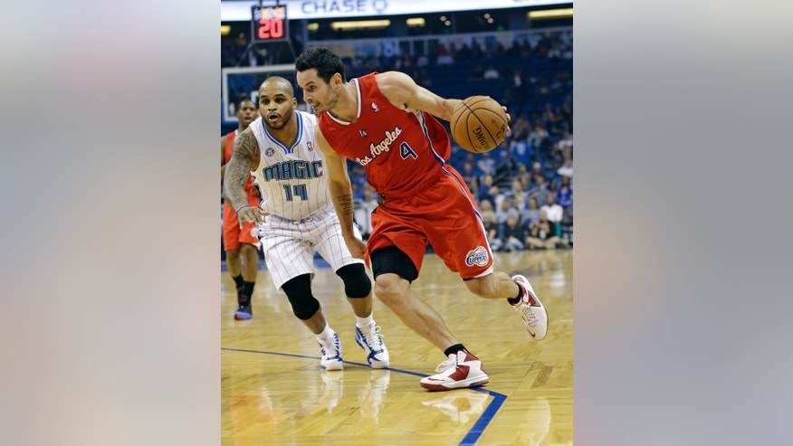 Los Angeles Clippers' J.J. Redick (4) drives to the basket past Orlando Magic's Jameer Nelson (14) during the first half of an NBA basketball game in Orlando, Fla., Wednesday, Nov. 6, 2013. (AP Photo/John Raoux)
