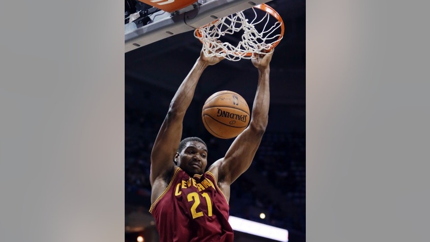 Cleveland Cavaliers' Andrew Bynum dunks during the first half of an NBA basketball game against the Milwaukee Bucks on Wednesday, Nov. 6, 2013, in Milwaukee. (AP Photo/Morry Gash)