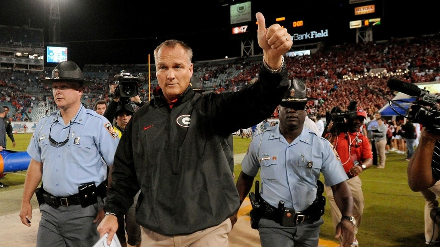 Georgia head coach Mark Richt gives a thumbs up to the fans after their 23-20 win over Florida in an NCAA football game, Saturday, Nov. 2, 2013, in Jacksonville, Fla. (AP Photo/Stephen Morton)