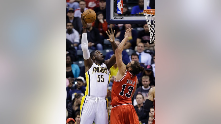 Indiana Pacers center Roy Hibbert, left, shoots over Chicago Bulls center Joakim Noah in the first half of an NBA basketball game in Indianapolis, Wednesday, Nov. 6, 2013. (AP Photo/Michael Conroy)