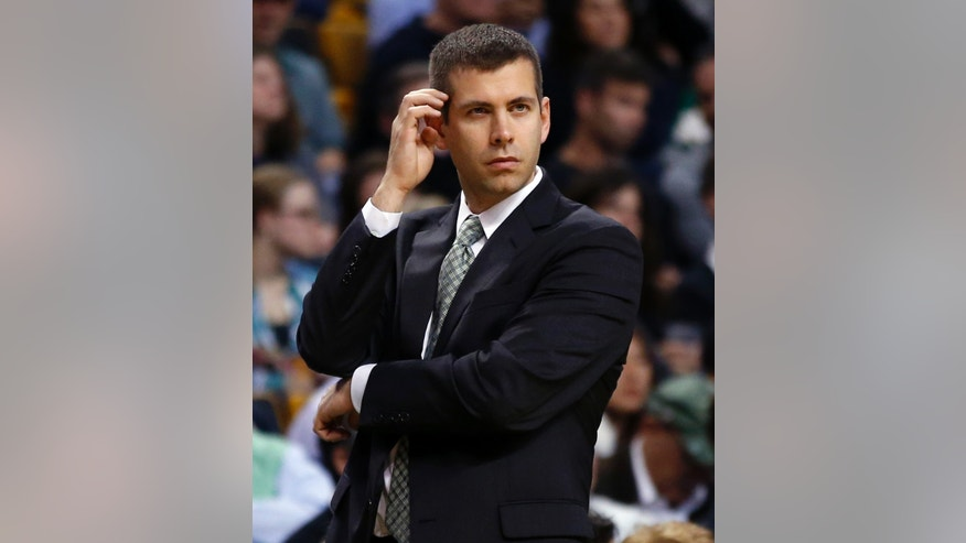 Boston Celtics coach Brad Stevens reacts on the sidelines during the second half of an NBA basketball game in Boston Wednesday, Nov. 6, 2013. The Celtics defeated the Utah Jazz 97-87. (AP Photo/Elise Amendola)