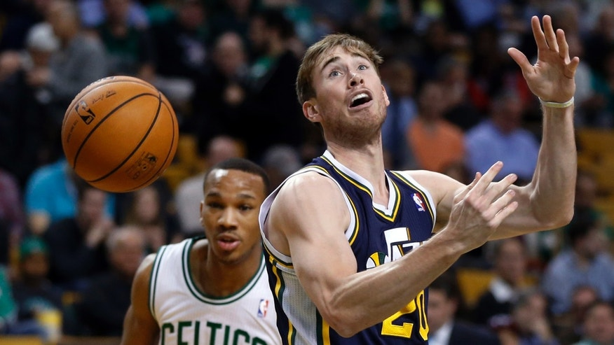 Utah Jazz forward Gordon Hayward (20) loses control of the ball as Boston Celtics guard Avery Bradley (0) moves in at left during the first quarter of an NBA basketball game in Boston on Wednesday, Nov. 6, 2013. (AP Photo/Elise Amendola)