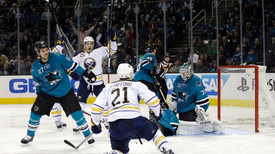 Buffalo Sabres' Drew Stafford (21) scores past San Jose Sharks goalie Antti Niemi, of Finland, right, during the second period of an NHL hockey game on Tuesday, Nov. 5, 2013, in San Jose, Calif. (AP Photo/Marcio Jose Sanchez)