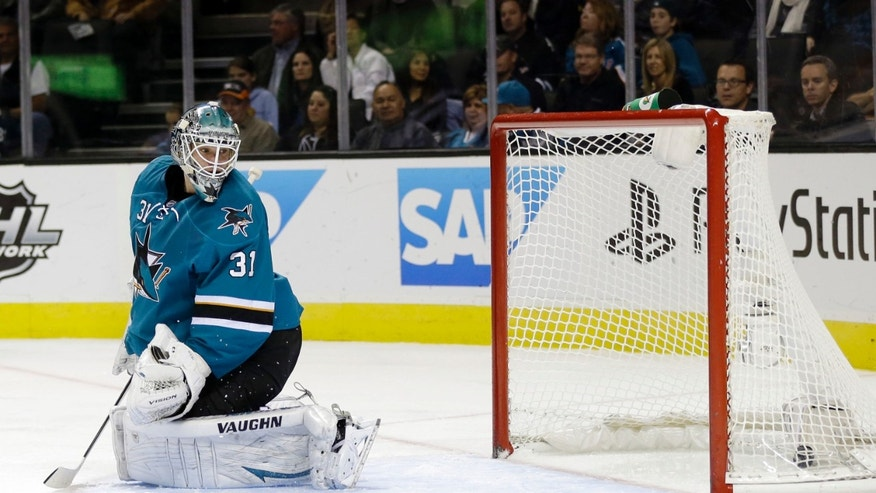 A shot from Buffalo Sabres' Cody McCormick gets past San Jose Sharks' Antti Niemi (31), of Finland, for a goal during the second period of an NHL hockey game on Tuesday, Nov. 5, 2013, in San Jose, Calif. (AP Photo/Marcio Jose Sanchez)