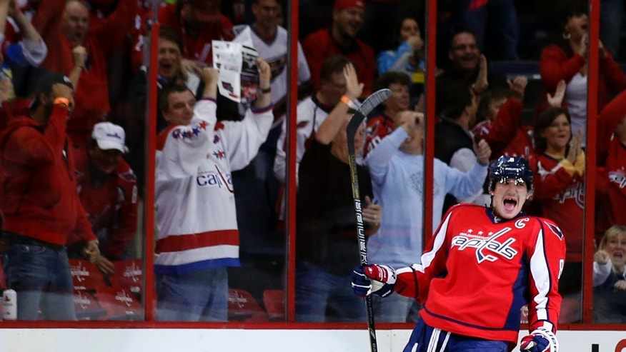 Washington Capitals right wing Alex Ovechkin, from Russia, celebrates his goal in the first period of an NHL hockey game against the Minnesota Wild, Thursday, Nov. 7, 2013, in Washington. (AP Photo/Alex Brandon)