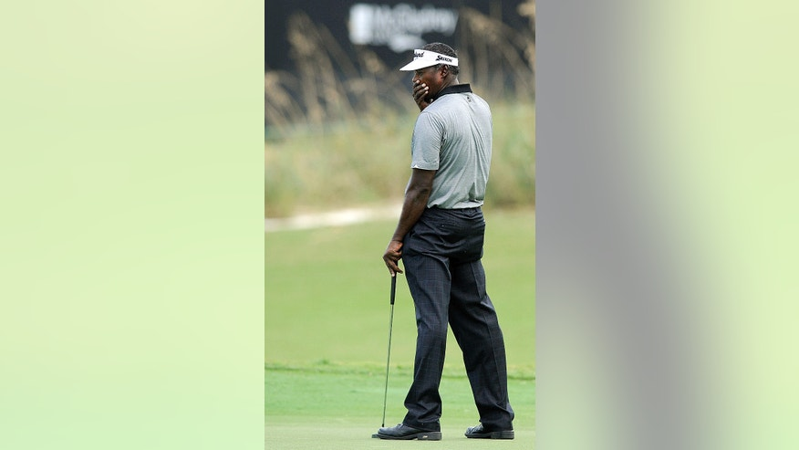Vijay Singh, of Fiji, reacts to a missed putt the 17th green during the first round of the McGladrey Classic golf tournament on Thursday, Nov. 7, 2013, in St. Simons Island, Ga. (AP Photo/Stephen Morton)