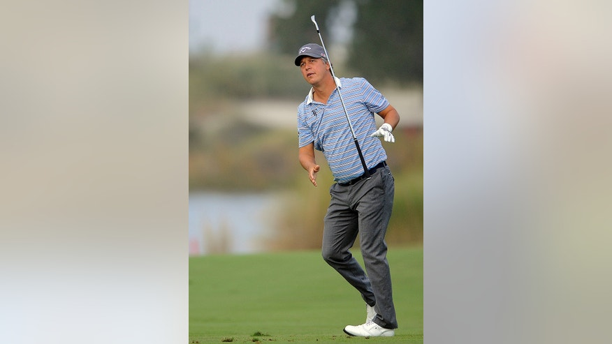 Freddie Jacobson, of Sweden, reacts to his shot from the seventh fairway during the first round of the McGladrey Classic golf tournament on Thursday, Nov. 7, 2013, in St. Simons Island, Ga. (AP Photo/Stephen Morton)