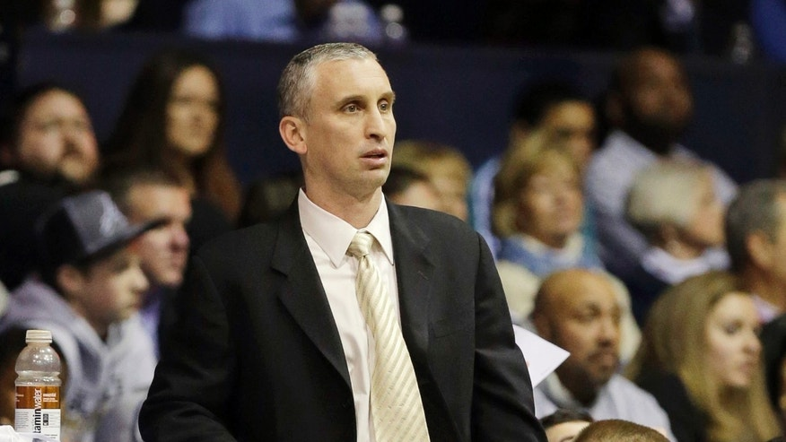 FILE - In this Feb. 2, 2013, file photo, Rhode Island assistant coach Bobby Hurley watches during the second half of an NCAA college basketball game against Butler in Indianapolis. At age 42, Hurley gets his first shot at being a head coach, at Buffalo. (AP Photo/Michael Conroy, File)