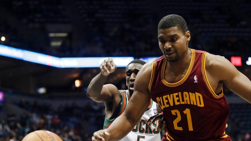 Milwaukee Bucks' Ekpe Udoh, rear, knocks the ball away from Cleveland Cavaliers' Andrew Bynum during the first half of an NBA basketball game Wednesday, Nov. 6, 2013, in Milwaukee. (AP Photo/Morry Gash)