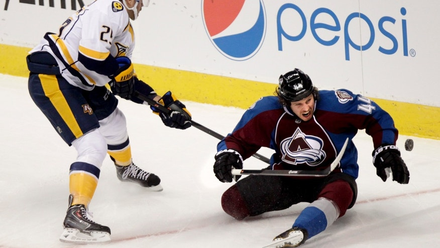 Nashville Predators' Viktor Stalberg (25), of Sweden, and Colorado Avalanche defenseman Ryan Wilson (44) compete for the puck during the first period of an NHL hockey game Wednesday, Nov. 6, 2013, in Denver. (AP Photo/Barry Gutierrez)