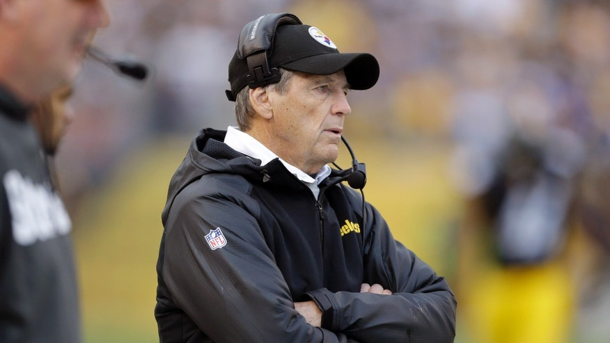 FILE - In this Oct. 20, 2013, file photo,  Pittsburgh Steelers defensive coordinator Dick LeBeau stands on the sidelines during an NFL football game against the Baltimore Ravens in Pittsburgh. The Steelers defense that has been one of the best under Lebeau for over a decade is now struggling and looking for answers after giving up a team record number of points and total offense in a 55-31 loss to the New England Patriots on Nov. 3, 2013. (AP Photo/Gene J. Puskar, File)