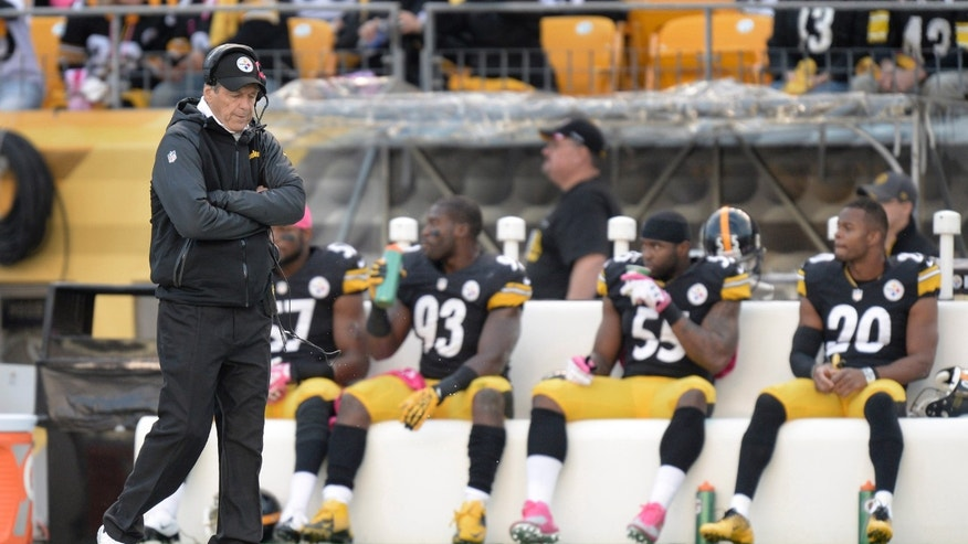 FILE - In this Oct. 20, 2013, file photo, Pittsburgh Steelers defensive coordinator Dick LeBeau paces the sideline in front of some of the defense during an NFL football game against the Baltimore Ravens in Pittsburgh. The Steelers defense that has been one of the best under Lebeau for over a decade is now struggling and looking for answers after giving up a team record number of points and total offense in the 55-31 loss to the New England Patriots on Nov. 3, 2013. (AP Photo/Don Wright, File)