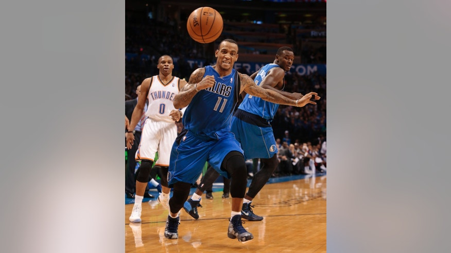 Dallas Mavericks guard Monta Ellis (11) tries to recover a loose ball during an NBA basketball game against the Oklahoma City Thunder in Oklahoma City, Wednesday Nov. 6, 2013. (AP Photo/Brett Deering)
